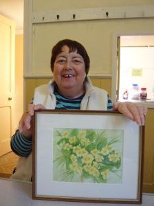 Sue proud as punch with her framed flower painting in 2009