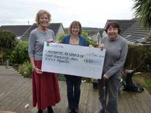 Sue presenting a cheque to the Arthritis Research UK Charity in 2010